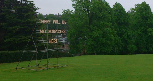 """There will be no miracles here."" The grounds of my girlfriend's workplace. I took this before we met. I disagree wholeheartedly."